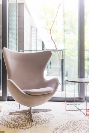 White modern arm chair in living room photo