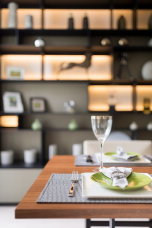 Modern style dish set on the table in dining room photo