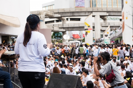 dam square: BANGKOK - September 22  Gathered protesters front of stage as Stop EHIA campaign at Pathum Wan Intersection in Bangkok, Thailand