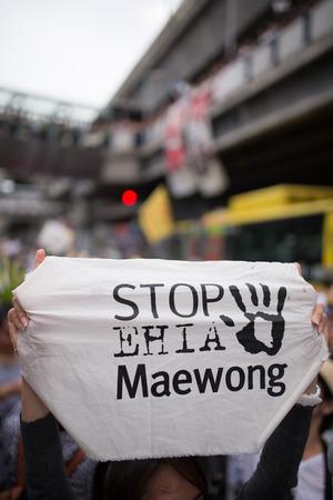 dam square: BANGKOK - September 22   Protester s sign showing as Stop EHIA campaign at Pathum Wan Intersection in Bangkok, Thailand