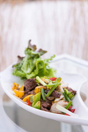 Black pepper spicy stir fried beef with onions photo