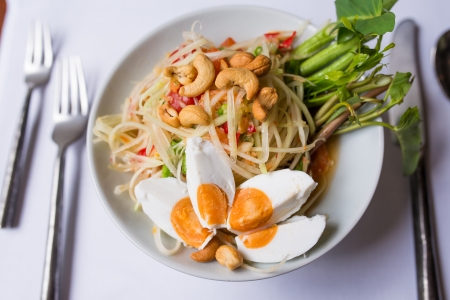 Papaya salad spicy with salted eggs photo