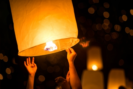 chiangmai: People is launching sky lantern to the sky Stock Photo