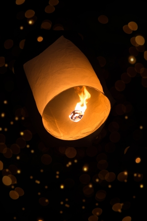 sky lantern with bokeh in the dark photo