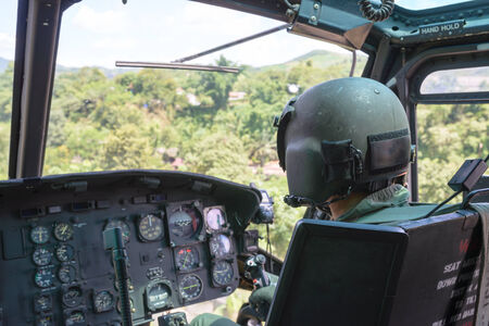 Military pilot flying helicopter photo