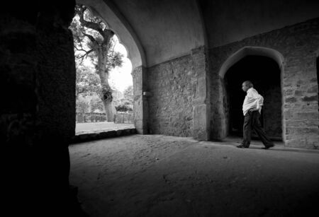 Walking indian man in Qutub Minar