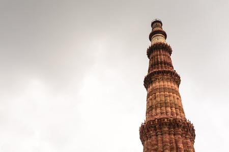 minar: Qutub Minar tower on dull sky