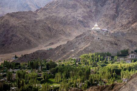 settle: Shanti Stupa settle on rock mountain over city of Leh