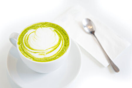 green tea latte art in white cup,isolated