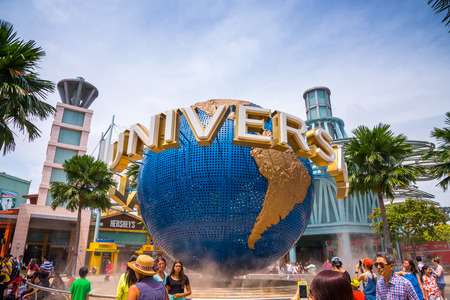 SINGAPORE, AUGUST 26,2013 : Travelers take photos with Universal land mark on August 26, 2013 in Singapore