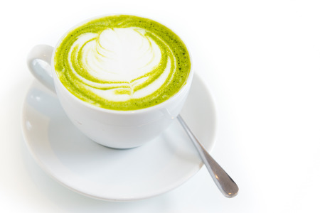 cream tea: green tea latte art in white cup,isolated