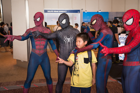 paragon: BANGKOK - MAY 11,2014 : Unidentified kid take photo with Spiderman cosplay in Thailand Comic Con 2014 on May 11, 2014 at Siam Paragon, Bangkok, Thailand. Editorial