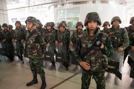 ta: BANGKOK - MAY 25: Military soldier wall blocking skywalk due to anti coup riot, May 25, 2014 in Bangkok, Thailand.