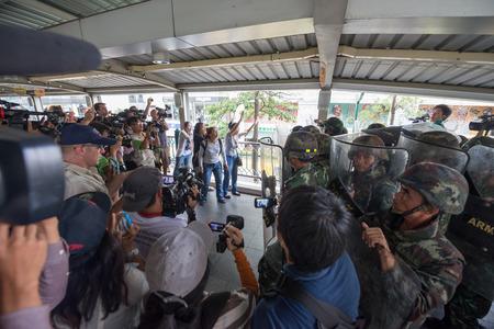 coup: BANGKOK - MAY 25: Anti coup arguing with soldiers on media news, May 25, 2014 in Bangkok, Thailand. Editorial