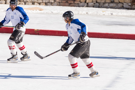 strenght: LEH - FEBRUARY 13,2014 : Unidentified ice hockey player challenging in Ladakh on February 13, 2014 at Leh, India Editorial