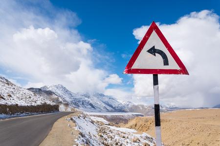 turn left sign: turn left sign mountain road