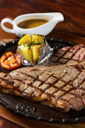 t bone steak: hot pan grilled beef T bone steak Stock Photo