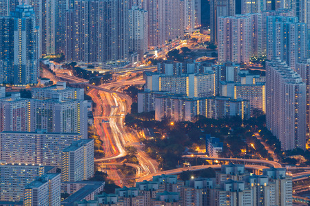 overcrowded: traffic light trail in overcrowded cityscape