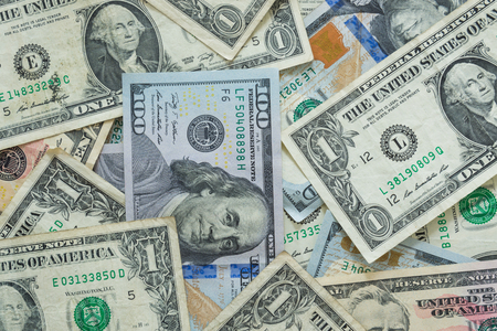 variety of US dollar bills background photo