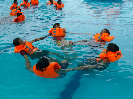 emergency vest: BANGKOK, THAILAND - JULY 31 : Seaman overboard sea formation drill practice on July 31, 2014 in Bangkok, Thailand.