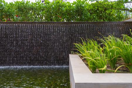 water feature: hotel garden wall waterfall pool