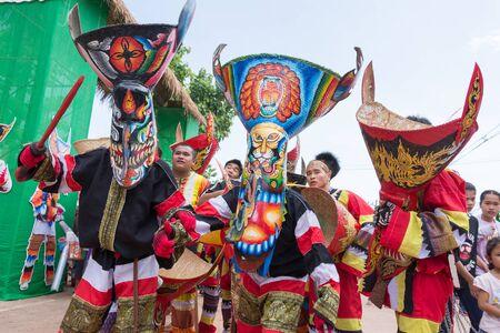 LOEI, THAILAND - JUNE 28 : Group of mascot player in Phi ta khon halloween festival on June 28 2014 in Loei, Thailand Redakční