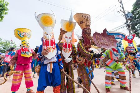 LOEI, THAILAND - JUNE 28 : Group of mascot player in Phi ta khon halloween festival on June 28 2014 in Loei, Thailand