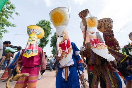 LOEI, THAILAND - JUNE 28 : Group of mascot player in Phi ta khon halloween festival on June 28 2014 in Loei, Thailand