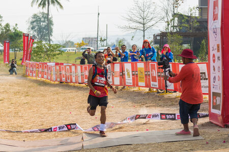 1st place: PAKCHONG, THAILAND - JANUARY 31 : K.Sayan 1st place winner of 100km trail running in The North Face 100 event on January 31, 2015 in Pakchong, Thailand.