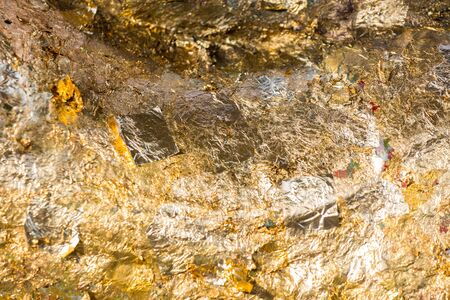 grunge worn gold leaf background texture photo