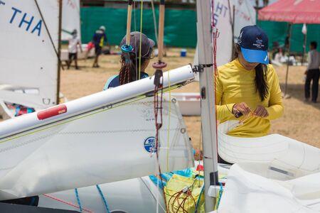 optimist: JOMTIEN, THAILAND - MAY 01 : Unidentified racer preparing her Optimist ship in Top of the Gulf Regatta event at Jomtien beach Pataya May 01, 2015