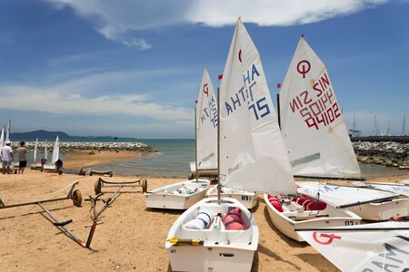 optimist: JOMTIEN, THAILAND - MAY 01 : Optimist boats on shore in Top of the Gulf Regatta event at Jomtien beach Pataya May 01, 2015 Editorial