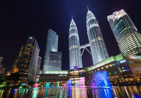 KUALA LUMPUR MALAYSIA  APRIL 15: night scene of Petronas Twin towers Suria KLCC fountain at Kuala Lumper Malaysia on April 152015