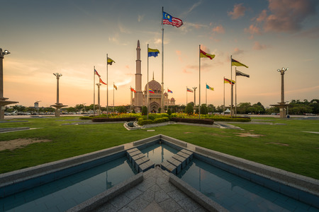 PUTRAJAYA MALAYSIA  APRIL 16: Tourist view towards Putra Mosque from flags square at Putrajaya Malaysia on April 162015