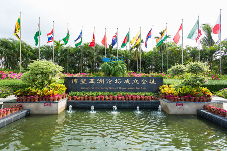 BOAO  CHINA MAY 11 : international flags Inaugural Ceremony Site sign in front of Boao forum for asia theme park in Hainan ChinaMay 11 2015 Redakční