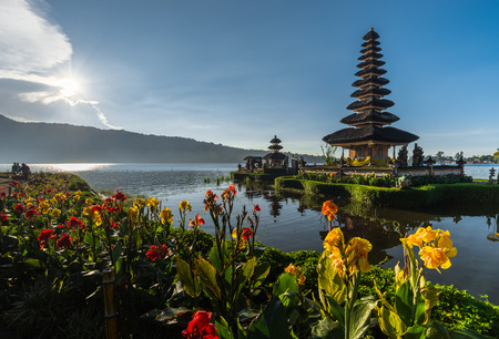 flowers Pura Ulun Danu temple on a lake Beratan, Bali, Indonesia, HDR style 版權商用圖片