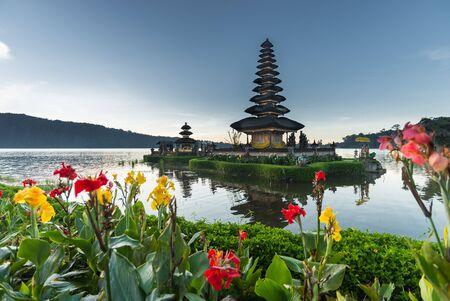 ulun: flowers Pura Ulun Danu temple on a lake Beratan, Bali, Indonesia, HDR style Stock Photo