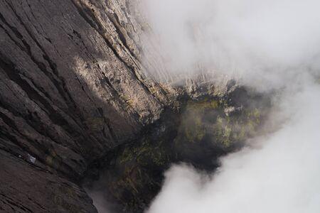 active volcano: Bromo active volcano crater sulfur fog mist Stock Photo