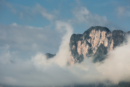 national fruit of china: lime stone mountain forest cloudy mist Stock Photo