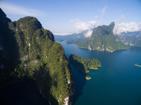 national fruit of china: aerial shot of lime stone island sea cloud blue sky Stock Photo