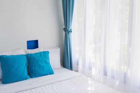matress: light blue theme pillows white mattress bedroom light through curtain