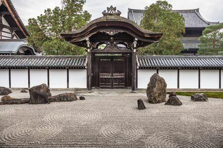 Zen stone pebble garden in surrounding wall