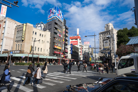 People walking cross road zebra in traffic midtown tokyo