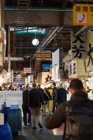 People walking in Tsukiji fish market, Tokyo Japan