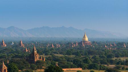 Golden pagoda among pagoda field in Bagan, Myanmar