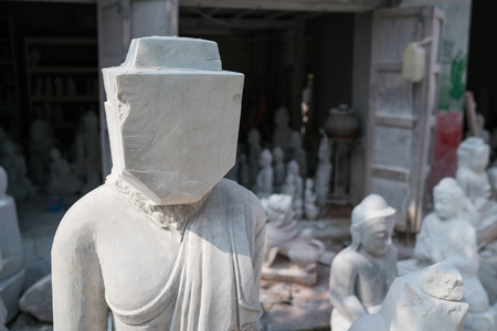 faceless buddha marble statue prepared for cutting