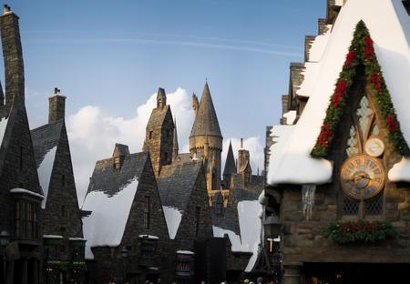 Hogwarts castle behind Hogsmeade village from Harry Potter movies in Universal Studios Japan Redakční