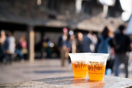 glasses of Butterbeer famous drinks in Harry Potter movies on display in Universal Studios Japan Redakční
