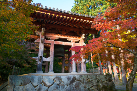 Japanese style ancient big temple bell in autumn garden