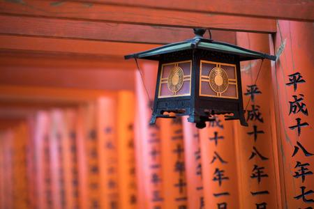 japanese hanging lamp on red wooden torii gates in Fushimi Inari temple Reklamní fotografie
